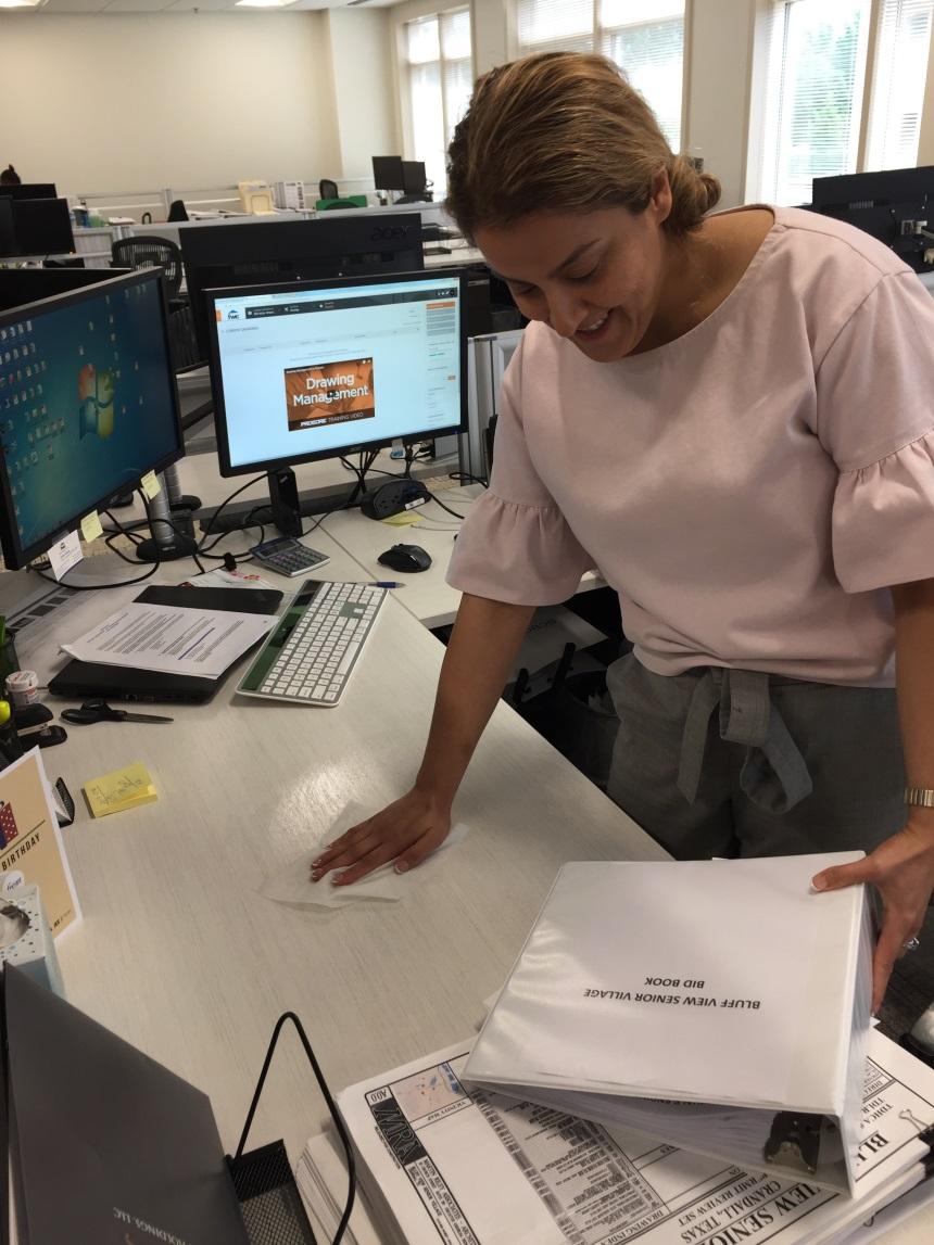 FWC Project Coordinator Golnaz Ashouri Sanitizes Her Desk During Desk Cleanup And Declutter.